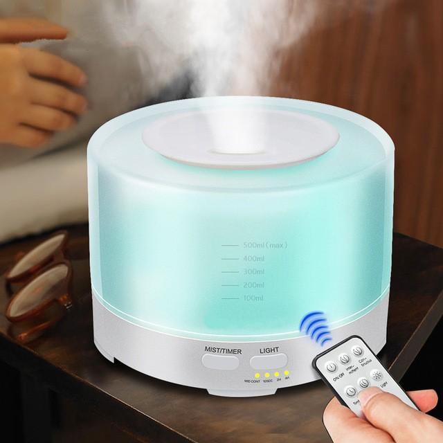 Máy phun sương khuyếch tán tinh dầu trụ tròn có đèn led 7 màu 500ml (có điều khiển từ xa) + tặng lọ tinh dầu sả chanh