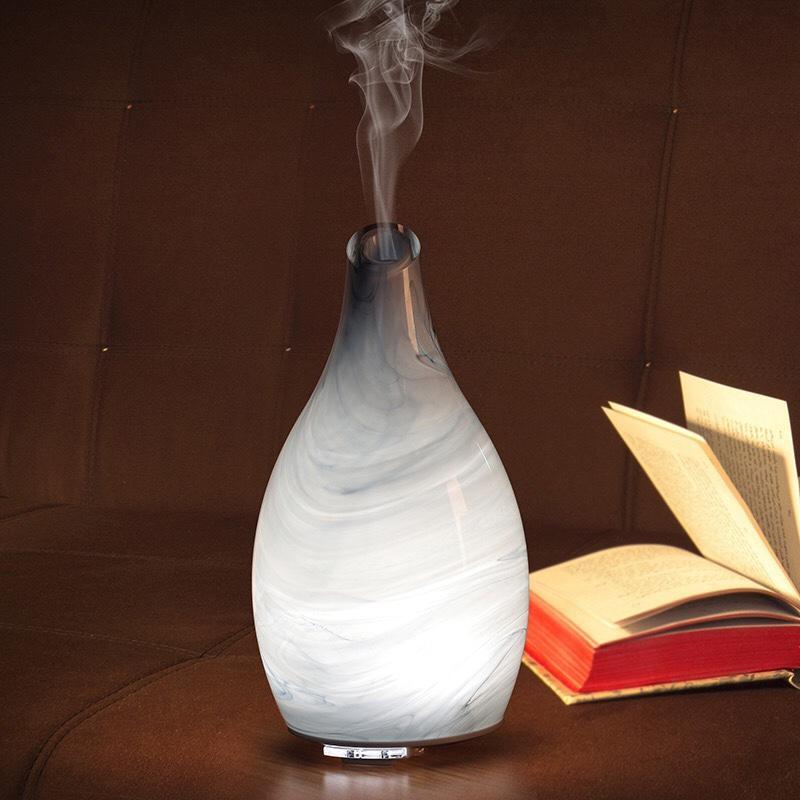 Máy khuếch tán tinh dầu bình thủy tinh trắng cao cấp 2 chế độ phun 8 tiếng dành cho phòng dưới 30m2 tặng 10ml tinh dầu ngọc lan tây Ngọc Tuyết
