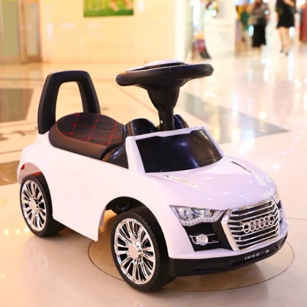 Xe chòi chân kiểu dáng ô tô cho bé có thùng đồ nhạc