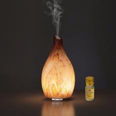 Máy phun sương tạo ẩm binh thủy tinh tặng 10ml tinh dầu sả chanh Ngọc Tuyết