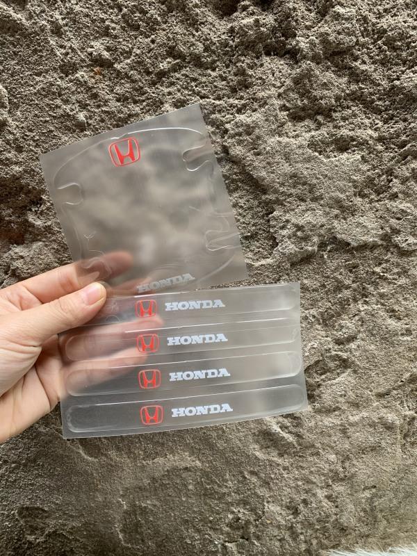 Bộ 8 Miếng dán Silicon chống xước hõm tay nắm cửa Ô tô kèm Logo xe ( Honda )
