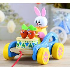 Hình ảnh Đồ chơi bằng gỗ - Bé kéo xe Thỏ con đánh trống