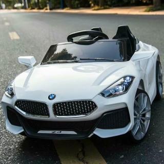 Ô tô xe điện trẻ em BMW Z4 tự lái và remote cho bé vận động ngoài trời (Đỏ-Trắng-Cam) thumbnail