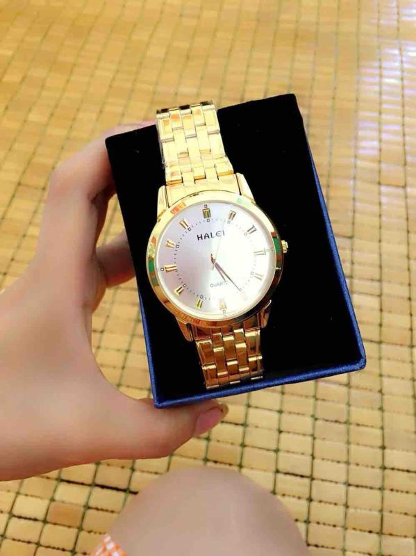 Đồng hồ nữ cao cấp,dây vàng mặt trắng .