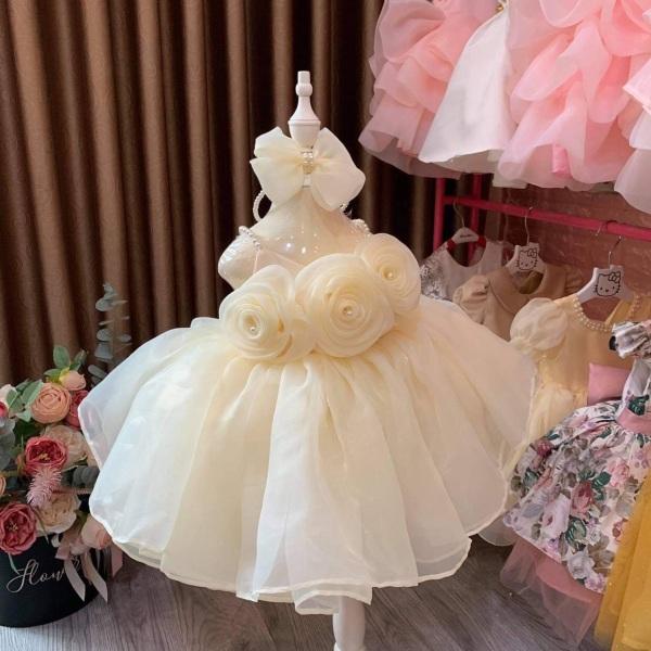 Giá bán Đầm công chúa màu kem tặng cài nơ (6-25kg)