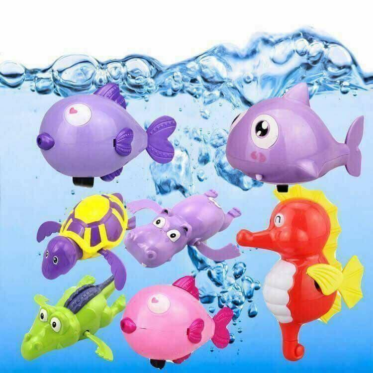 Bộ 3 đồ chơi nhà tắm vặn dây cót bơi...