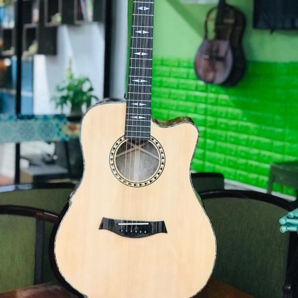 Đàn guitar gỗ XÁ XỊ nu nguyên tấm.