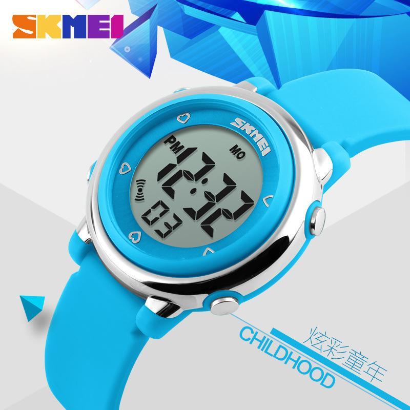 Giá bán Đồng hồ điện tử thời trang cho bé Skmei 1100 dây cao su dẻo mềm ,có đèn Led 7 màu, kiểu dáng siêu dễ thương