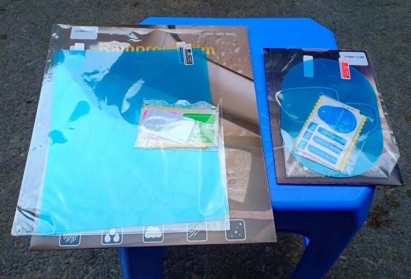Bộ 4 miếng dán chống bám nước mưa, 2 miếng dán kính (200*160mm), 2 miếng dán gương chiếu hậu (145*100mm)