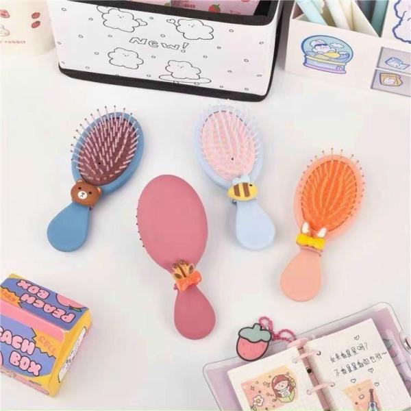 Lược gỡ rối kèm cột tóc xinh - Lược kim cao cấp chống rụng tóc - lược massage Dumi Shop