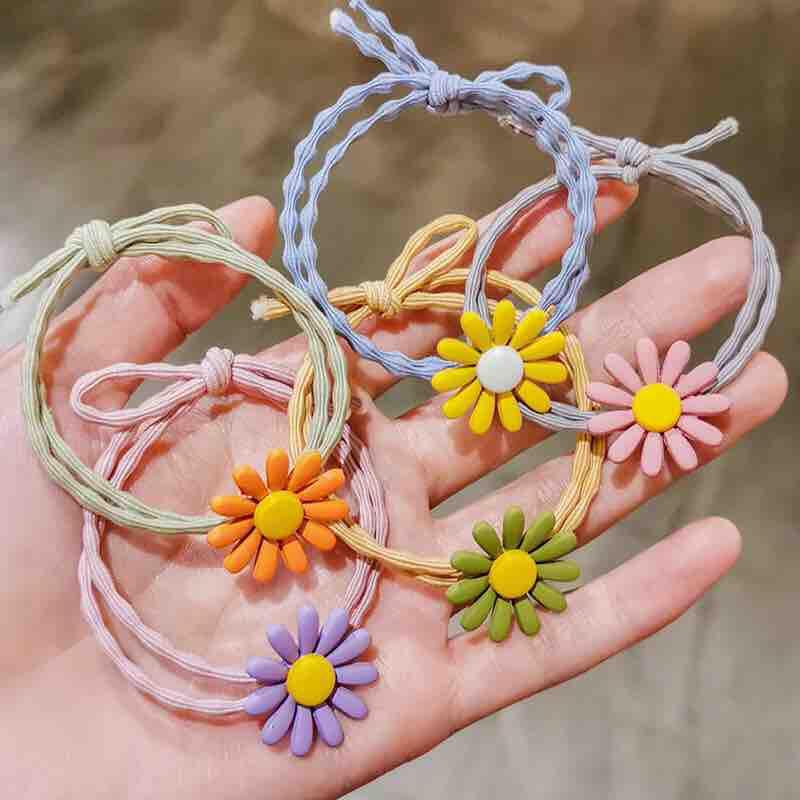 Dây cột tóc đính hoa cúc nhỏ nhập khẩu