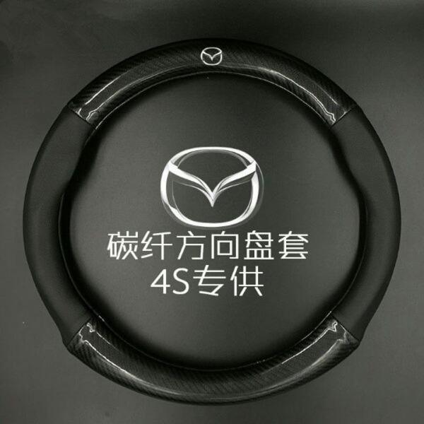 Bọc vô lăng cacbon biểu tượng Mazda -Nhà Buôn Đồ Chơi Xe Hơi