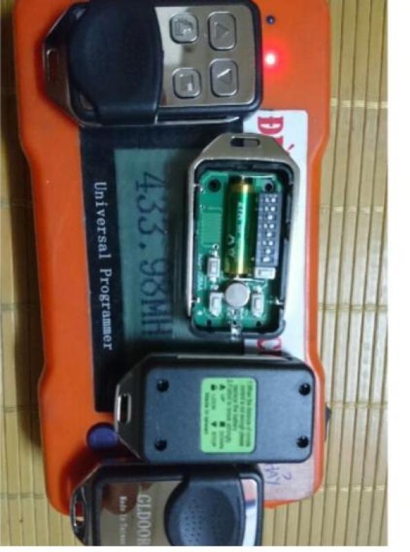 điều khiển remote cửa cuốn 8 mã gạt sóng 433