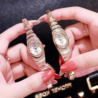 (TẶng kèm hộp và pin đồng hồ) Đồng hồ thời trang nữ DZG dây kim loại dạng lắc tay K744 thumbnail