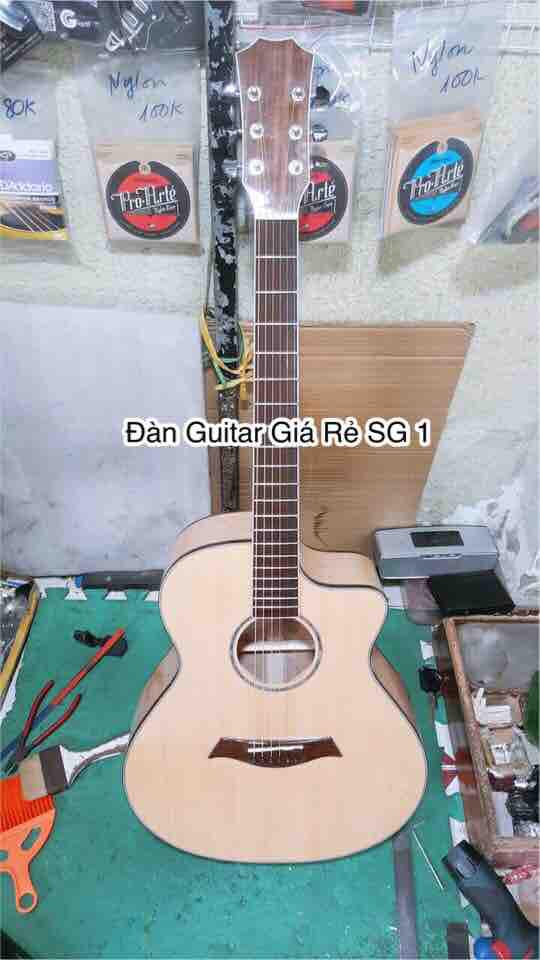 Guitar acoustic gỗ Còng cườm