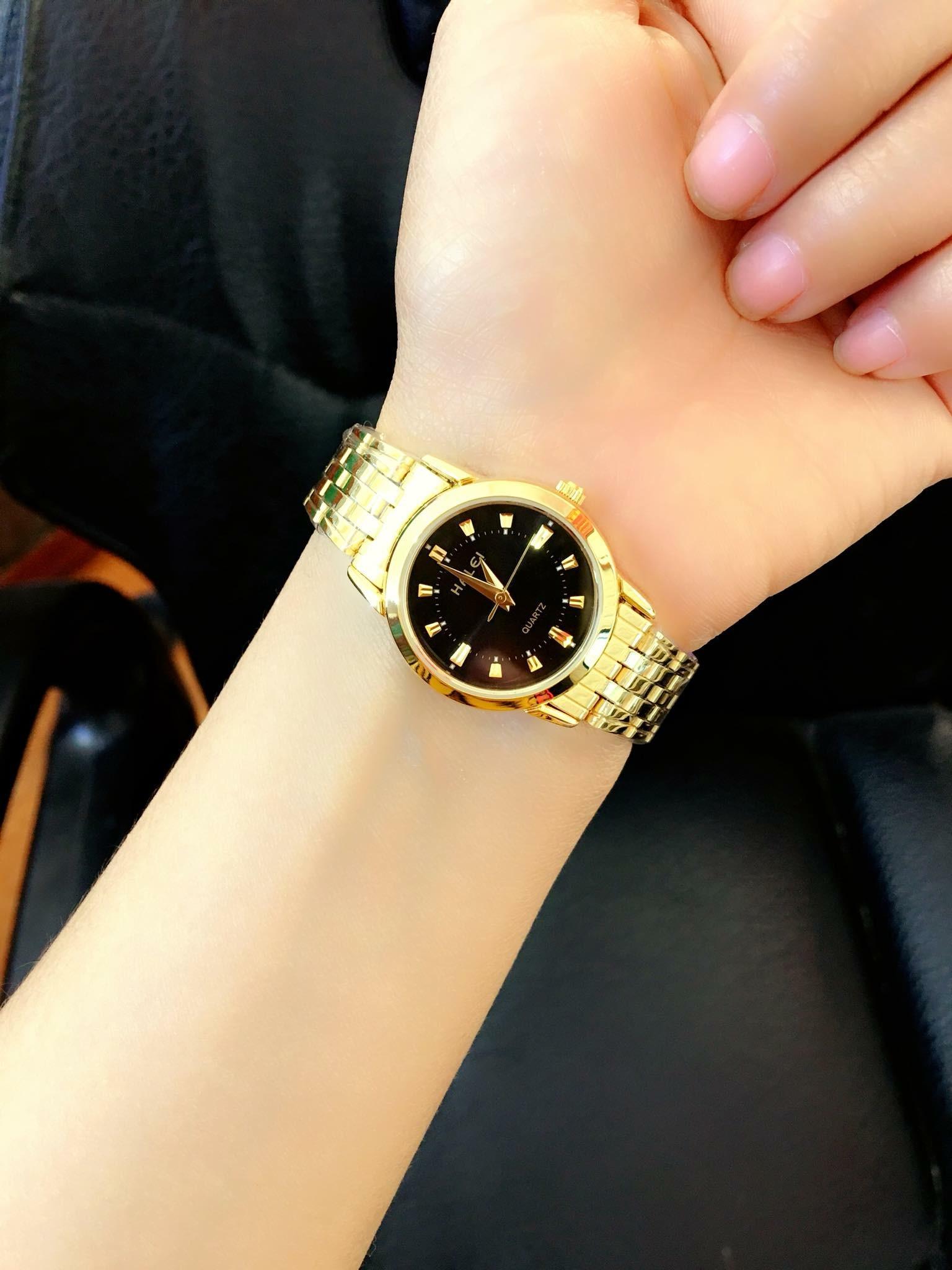đồng hồ nữ halei,dây vàng mặt đen,chống nước,chống xước tốt HL1213412 bán chạy