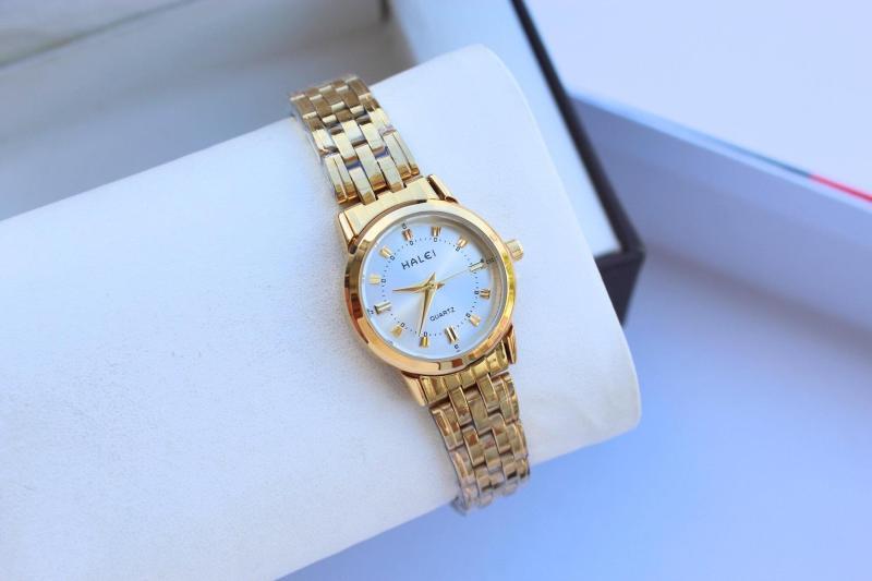 Đồng hồ nữ Halei dây vàng mặt trắng bền đẹp, tặng vòng tì hưu cá tính