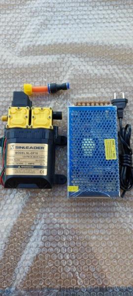 Bộ bơm đôi mini 12v sinleader kèm nguồn tổ ong 12V-10A , dùng để chế tưới loan , phun sương , rửa xe , còn tặng đầu ra 8mm ....vv
