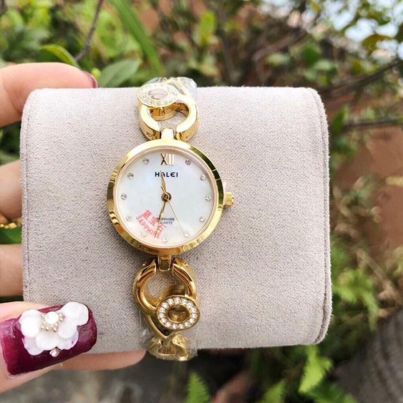 đồng hồ nữ lắc tay halei dây vàng mặt trắng,mặt kính sapphia chống xước,chống nước tốt