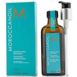 Tinh dầu dưỡng phục hồi tóc hư tổn khô xơ Moroccanoil Treatment 100ml