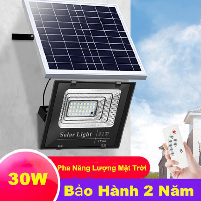Đèn  pha năng lượng mặt trời công suất 30W  kèm tấm pin rời có remote có cảm biến tự động dây nối 5m.Bảo hành 24 tháng